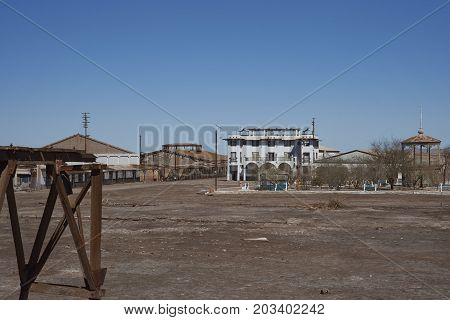 Chacabuco, Antofagasta Region, Chile - August 19, 2017: Town square and theatre in the derelict nitrate mining town of Chacabuco in the Atacama Desert of northern Chile