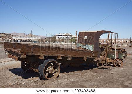 Chacabuco, Antofagasta Region, Chile - August 19, 2017: Abandoned vehicle in the derelict nitrate mining town of Chacabuco in the Atacama Desert of northern Chile