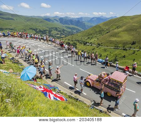 Col de PeyresourdeFrance- July 23 2014: Cochonou vehicle passing in the Publicity Caravn on the road to Col de Peyresourde in Pyrenees Mountains during the stage 17 of Le Tour de France 2014.