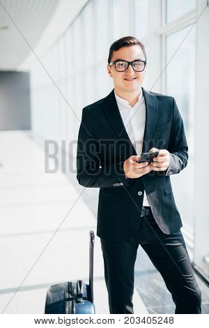 Handsome Businessman In Suit Read Sms On Phone In Terminal Near Gate Of Fly