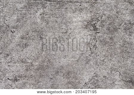 Grunge concrete texture. Grey asphalt road top view photo. Distressed and obsolete background texture. Natural concrete floor top view. Rustic asphalt road surface. Grungy grit backdrop. Shabby chic