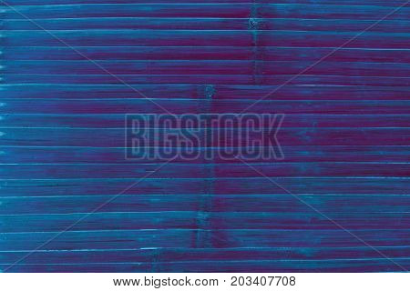 Wooden plank table top view. Deep blue toned photo texture. Obsolete wood table board. Rustic decor wallpaper backdrop. Vintage lumber surface grit. Colored bamboo plank board. Natural timber texture