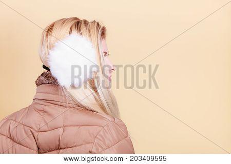 Blonde Woman In Winter Warm Earmuffs