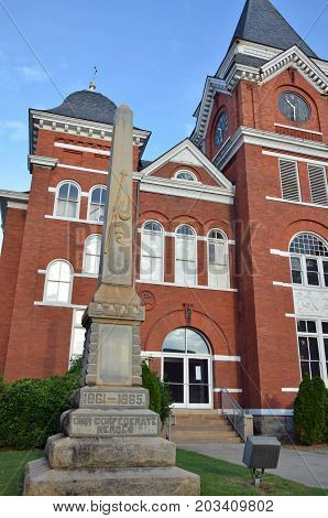 TALBOTTON, GA - August 27, 2017 A memorial statue to the service of Confederate soldiers stands before the historic Talbot County Courthouse.