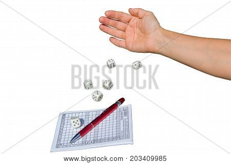 A woman's hand throws dice and plays a Yahtzee dice game