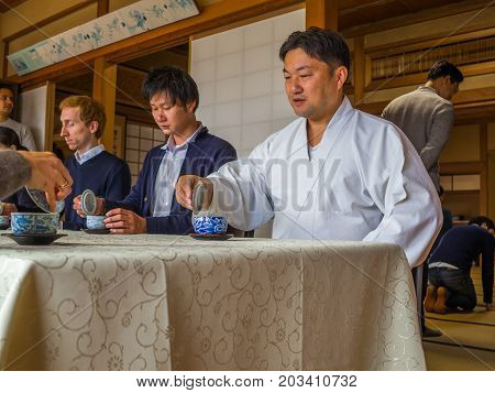 KYOTO, JAPAN - JULY 05, 2017: Unidentified people at table in a meeting reunion, drinking tea, in Kyoto, Japan