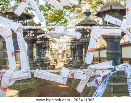 Nara, Japan - July 26, 2017: Beautiful and small prayer piece of paper at Todai Ji Temple, small pieces of paper used for wishes by shinto believers in Tokyo.