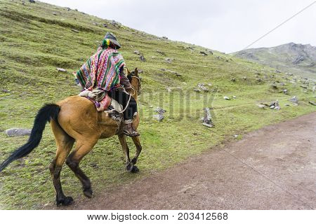 A native with his mule in front of the mountains