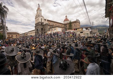 July 24 2017 Cotacachi Ecuador: indigenous kichwa people fill up the main plaza during Inti Raymi celebration