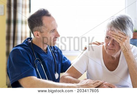 A Senior woman with the caregiver at home