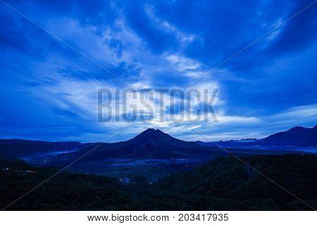 Scenic sunrise and mist at Batur volcano Kintamani Bali Indonesia. Sunrise view of Batur volcano Bali island Indonesia. Bali volcano. Bali nature landscape