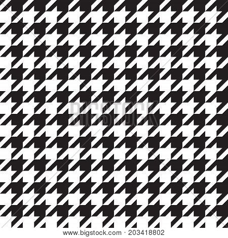 Seamless houndstooth pattern in black and white. Vector image.