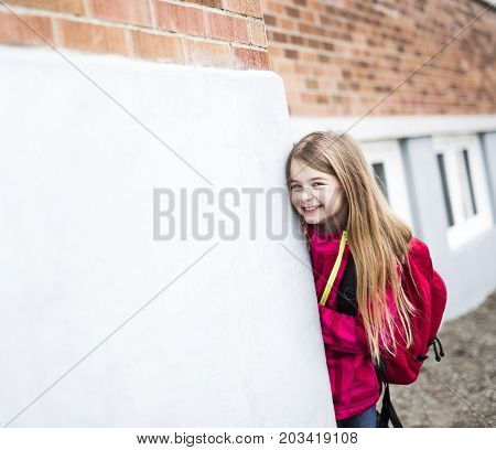 A Portrait of a Young Kid at school