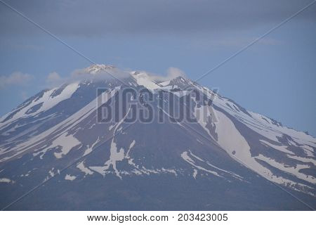 Dusk settling over Mt Shasta is a dormant volcano in the Cascade Mountain range located in Northern California