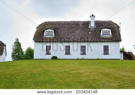 Fully restored old thatched roof cottage used as a hostel irish medieval and contemporary houses.