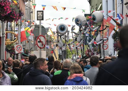 Shop Street, Galway, Ireland July , Art Festival 2017, I-puppets , 3 Puppets Making Performance On T