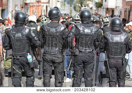 June 24 2017 Cotacachi Ecuador: riot police at the Inti Raymi parade at summer solstice