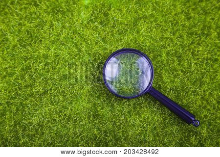 Magnifier on the grass close up .