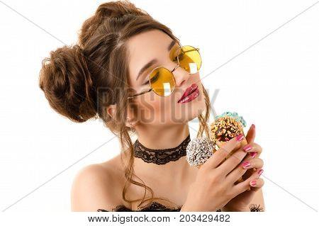 beautiful elegant woman with ice cream cones in hands