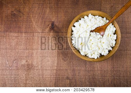 Cottage Cheese In A Wooden Bowl