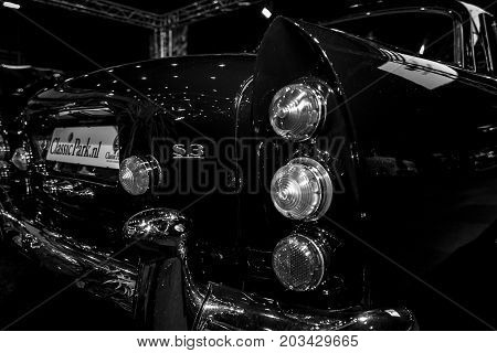 MAASTRICHT NETHERLANDS - JANUARY 08 2015: The rear brake lights of a full-size luxury car Bentley S3 Continental. Black and white. International Exhibition InterClassics & Topmobiel 2015
