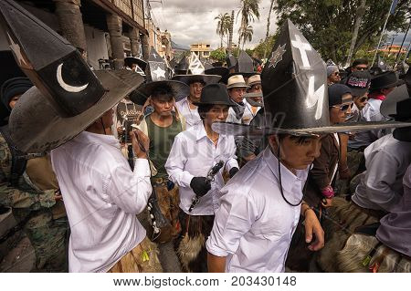 June 24 2017 Cotacachi Ecuador: indigenous kichwa men participating in a parade at summer solstice