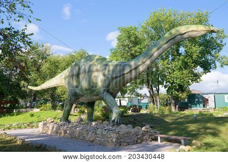 KOTELNICH, RUSSIA - AUGUST 30, 2017: A sculpture of apatosaurus in the paleontologic park in the sunny day
