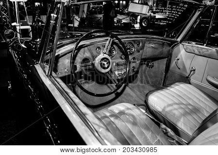 MAASTRICHT NETHERLANDS - JANUARY 08 2015: Cabin of a British sports car Alvis Three Litre TD21 DHC - Series I 1961. Black and white. International Exhibition InterClassics & Topmobiel 2015