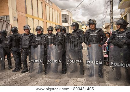 June 24 2017 Cotacachi Ecuador: riot police on duty at the Inti Raymi parade at summer solstice