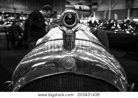 MAASTRICHT NETHERLANDS - JANUARY 08 2015: Hood ornament of a racing car Chrysler Imperial 80 Vitale Special 1927. Black and white. International Exhibition InterClassics & Topmobiel 2015