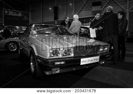 MAASTRICHT NETHERLANDS - JANUARY 08 2015: Sports car Maserati Biturbo Spyder designed and assembled by Zagato. Black and white. International Exhibition InterClassics & Topmobiel 2015
