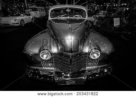 MAASTRICHT NETHERLANDS - JANUARY 08 2015: Full-size car Oldsmobile 98 De Luxe 1941. Black and white. International Exhibition InterClassics & Topmobiel 2015