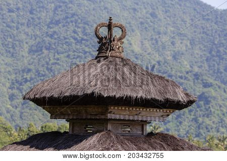 Thatched roof Hindu temple in city Ubud Bali Indonesia . Close up
