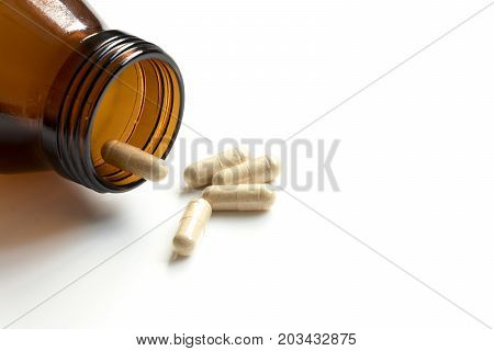 Capsule with amber bottle on white background and have the copy space for add text