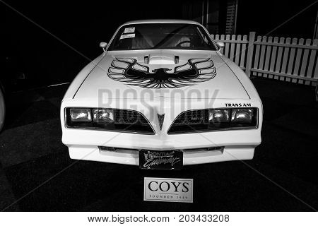 MAASTRICHT NETHERLANDS - JANUARY 08 2015: Muscle car Pontiac Firebird Trans Am 1977. Black and white. International Exhibition InterClassics & Topmobiel 2015