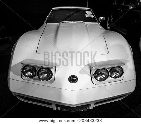 MAASTRICHT NETHERLANDS - JANUARY 08 2015: Sports car Chevrolet Corvette (C3) Stingray. Black and white. International Exhibition InterClassics & Topmobiel 2015