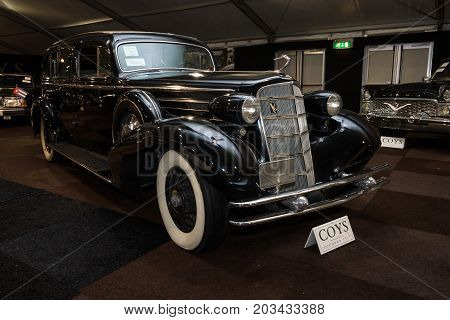 MAASTRICHT NETHERLANDS - JANUARY 08 2015: Oldtimer Cadillac V12 Fleetwood 30 Imperial Sedan 1934. International Exhibition InterClassics & Topmobiel 2015