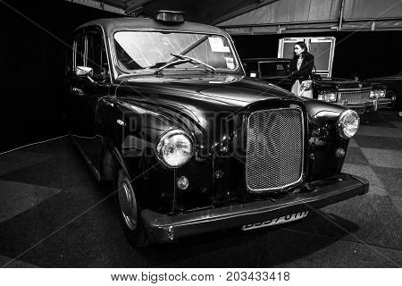 MAASTRICHT NETHERLANDS - JANUARY 08 2015: London taxi cab LTI FX4 (Austin FX4). Black and white. International Exhibition InterClassics & Topmobiel 2015