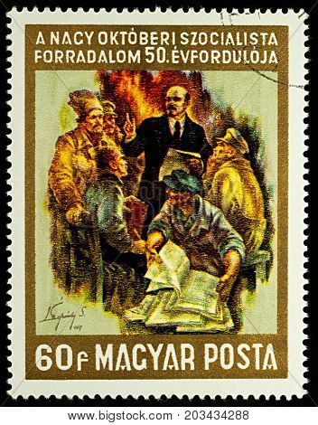 Moscow Russia - September 09 2017: A stamp printed in Hungary shows Lenin as teacher and propagandist series