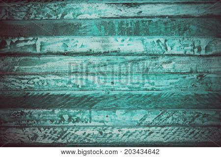 Turquoise vintage wood texture and background. Close up view of turquoise wood texture and background. Abstract background and texture for designers. Rustic table. Texture of handmade turquoise table.