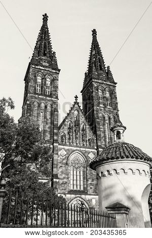 Beautiful basilica of Saint Peter and Saint Paul Vysehrad Prague Czech republic. Sunset photo. Religious architecture. Travel destination. Black and white photo.