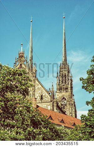 Famous Cathedral of St. Peter and Paul in Brno Moravia Czech republic. Religious architecture. Two big towers. Retro photo filter.