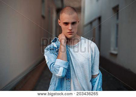 Stylish Handsome Man In Trendy Denim Jacket Posing Outdoors