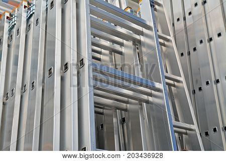 stack of industrial aluminium ladders at the store
