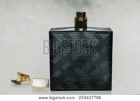 male perfume with cuff on grey background