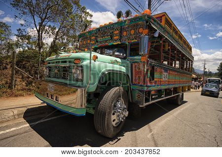 August 6 2017 Medellin Colombia: colourful old buses called 'chiva' used as party buses during the flower festival