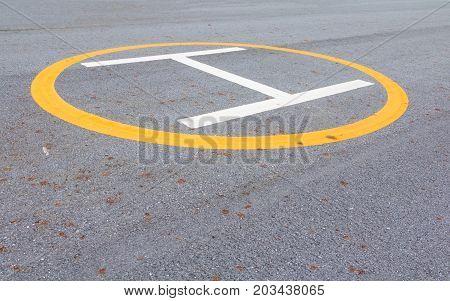 symbol landing pad. helicopter parked mark on the asphalt