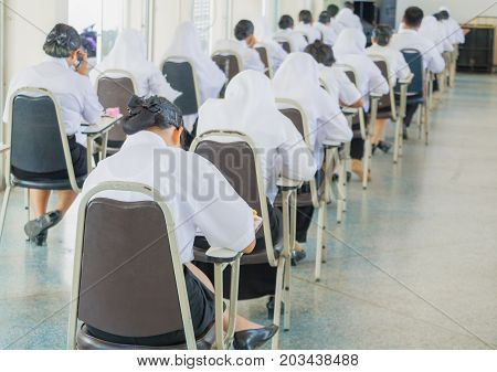 student sit chair classroom university in countryside for education test room and literacy concept. select focus with shallow depth of field.
