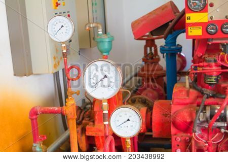 gauge scale on control system in the plumbing inside of building industrial