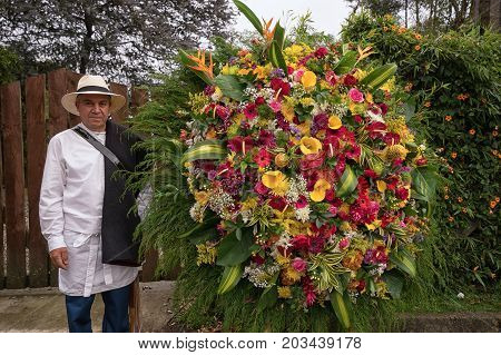 August 7 2017 Medellin Colombia: a farmer is posing with his floral display made for the annual flower festival parade